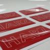 สติ๊กเกอร์เรซิ่น pvc พิมพ์ HAZE พื้นแดงเจาะสีขาว สวยๆๆๆ วาวๆๆ